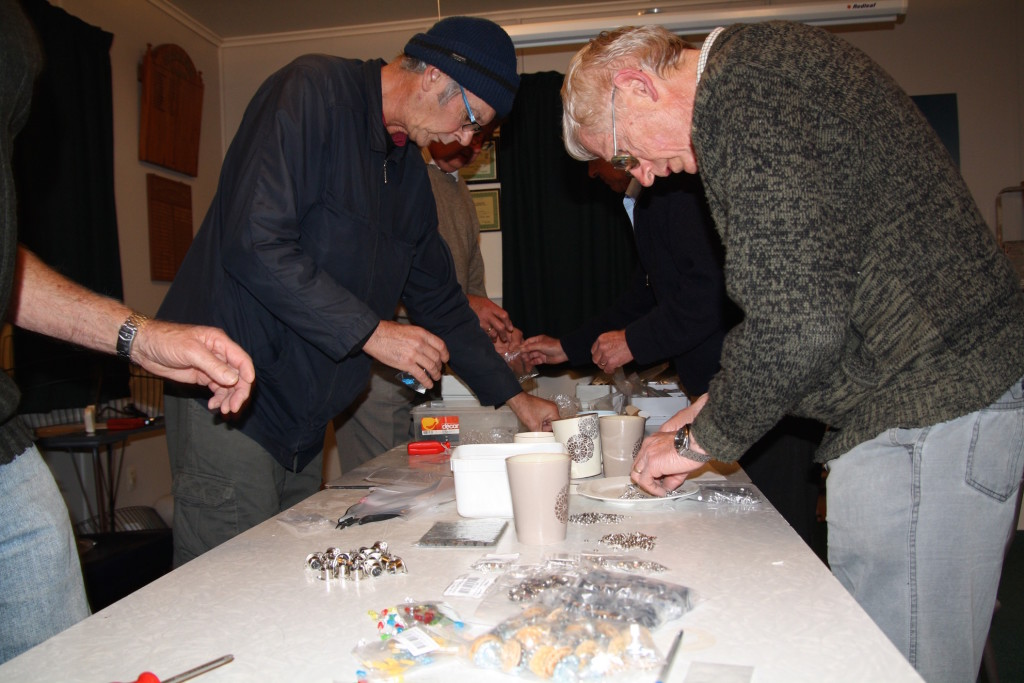 Many hands make light work counting out the hundreds of screws, nuts, washers and parts.